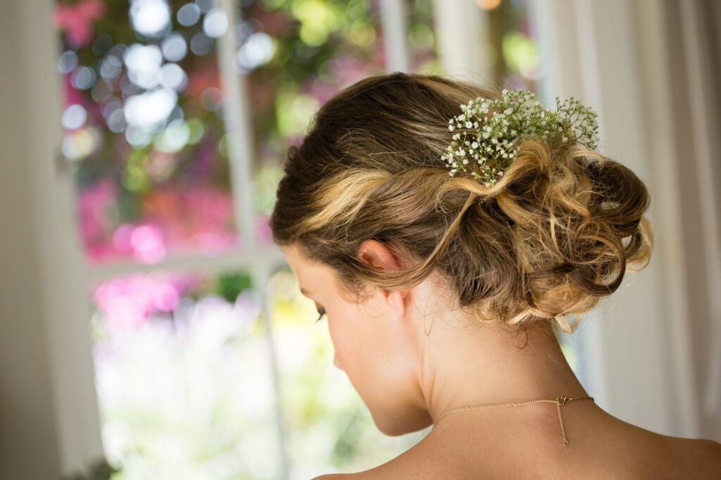 Close up of bride hair with flowers